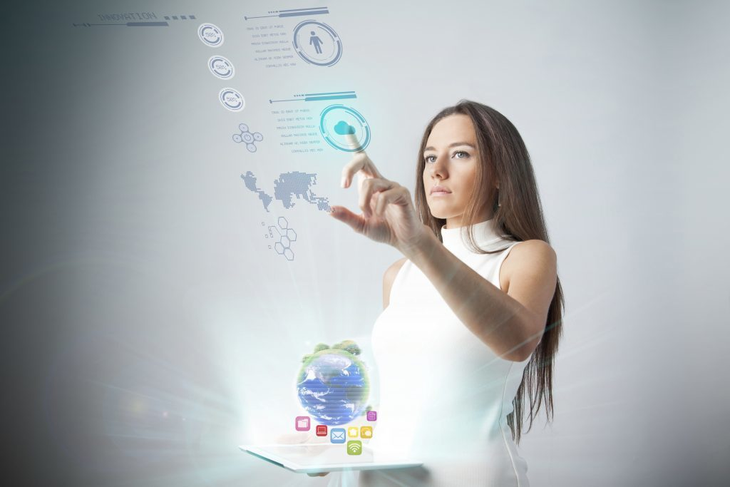 IStock, Young woman using new technologies by eternalcreative