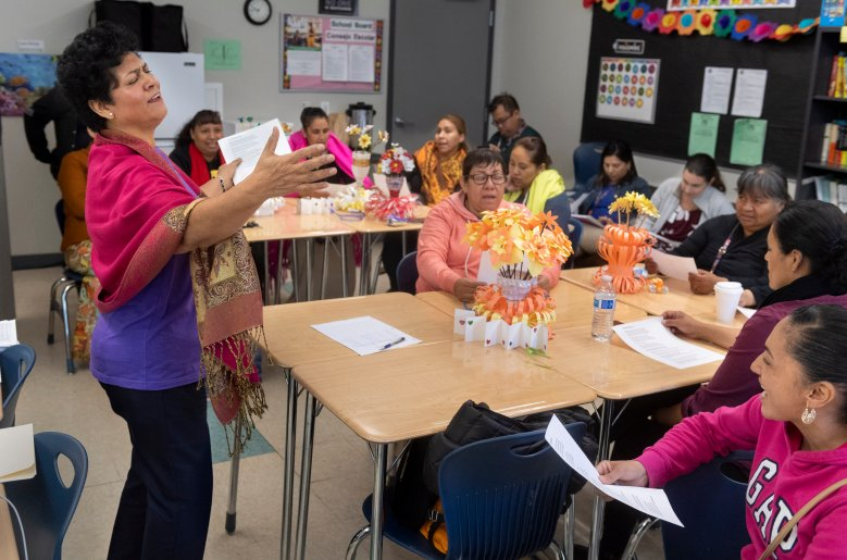 "Instructor Elsa Barajas with the Los Angeles Department of Mental Health sings a song about remembering your roots with students in a class called ""Traumatic Stress Caused by Immigration Law"" in Los Angeles, CA on Monday, November 4, 2019. The class is one of a series. (Photo by Paul Bersebach, Orange County Register/SCNG)"